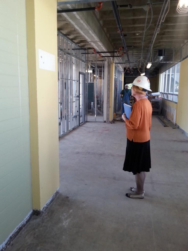 Louann contemplating the new lounge space in front of the Eddy 300 Computer Lab